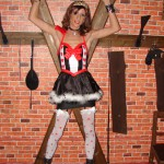 Queen of hearts in dungeon, striking pose